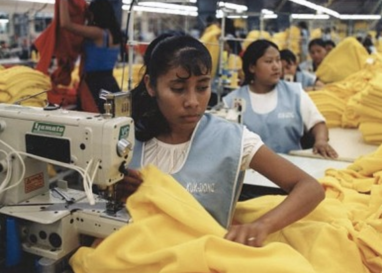Image of workers in a clothing factory