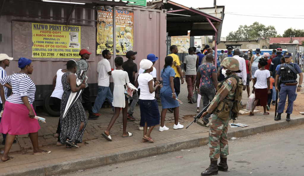 Image of police and military forces monitoring South Africans away in a bid to enforce lockdown regulations.