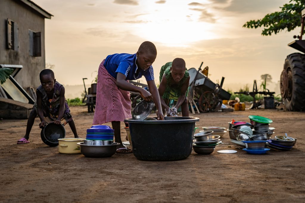 Children doing their dishes in Lome, Togo.