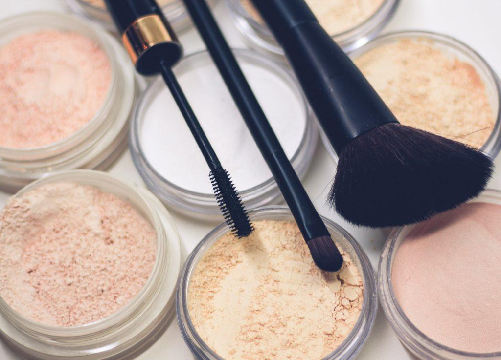 Image of make up powders, brushes and eyeliner