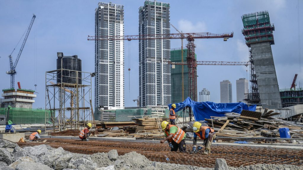 "Construction workers working at development hotspots of China's ""Belt & Road Initiative""."