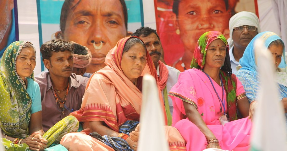 Dalit women sitting at a protest in India.