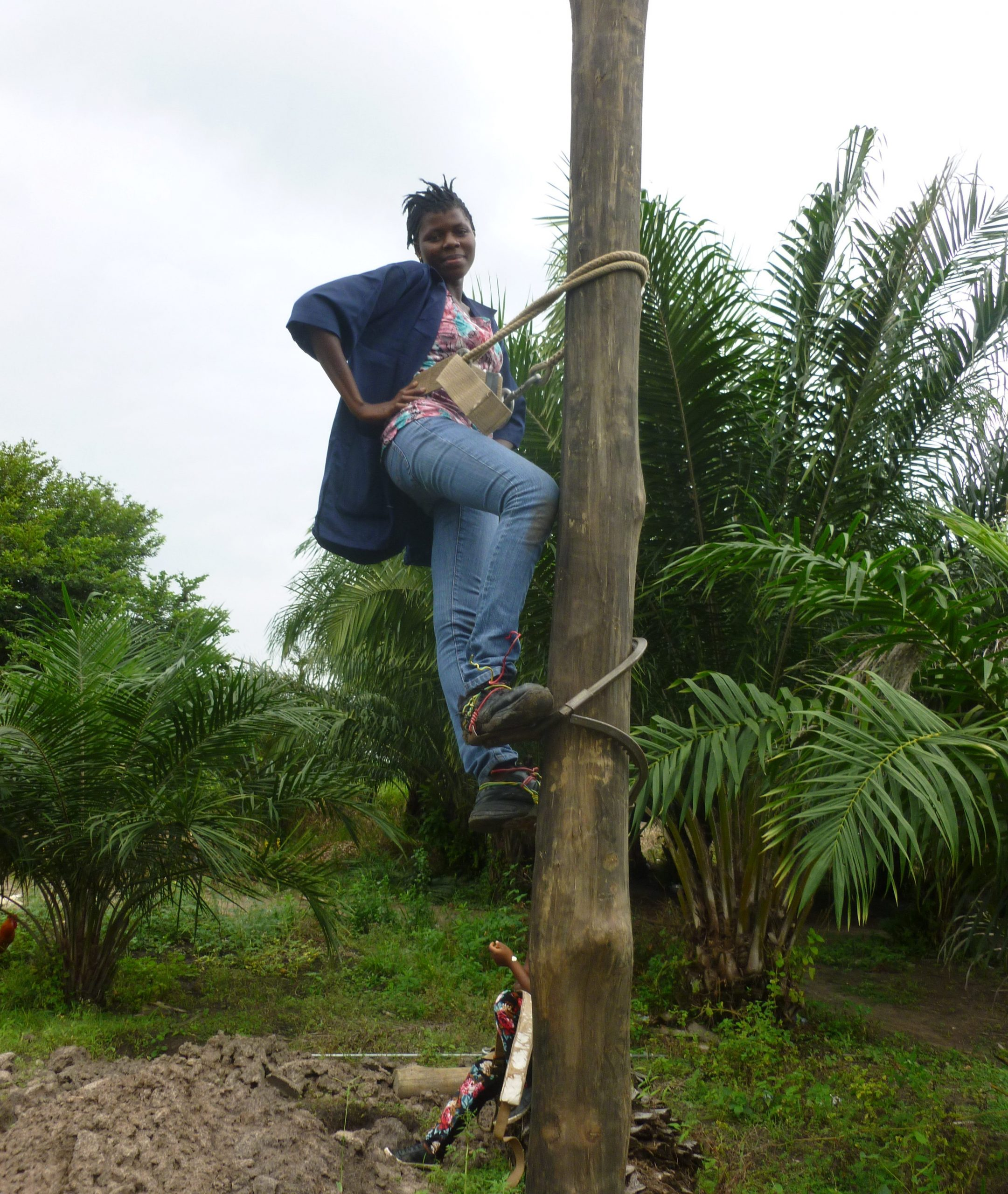 A female student recruited from a nearby village in Ho, Ghana. She can be seen on an electricity pole during her industrial attachment as part of  her course, General Electricity.