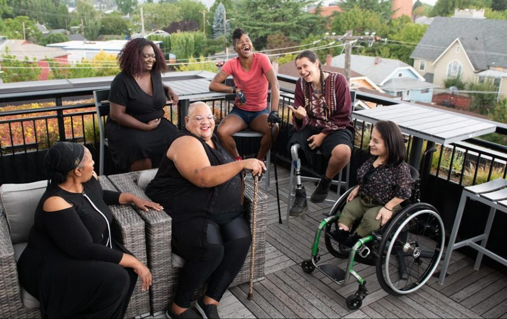 Image showing a group of persons living with disabilities of different ages