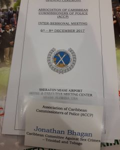 Image of a badge of Jonathan Bhagan at a meeting representing Caribbean Committee Against Sex Crimes