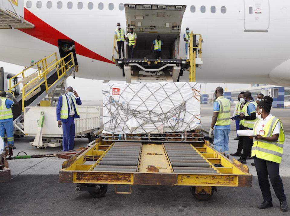 An image depicting the unloading of shipments containing COVID-19 vaccines at the Kotoka International Airport in Ghana