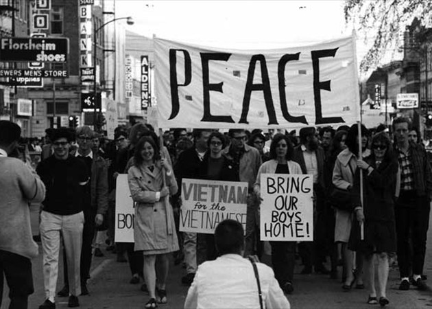 Photo of Protestors marching to  demand peace