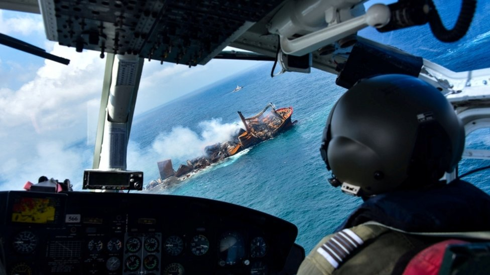 An image depicting the burning X-Press Pearl as seen on board an Army Chopper