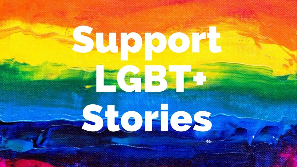 """Rainbow poster with the words """"Support LGBT+ stories"""""""