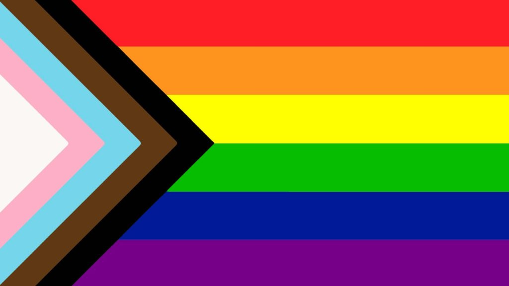 Pride flag that includes black, brown, blue, pink and white stripes in honor of the transgender community and people of color.