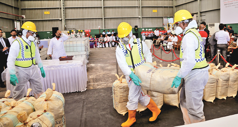 An image of Sri Lankan officials destroying a $108 Million haul of cocaine