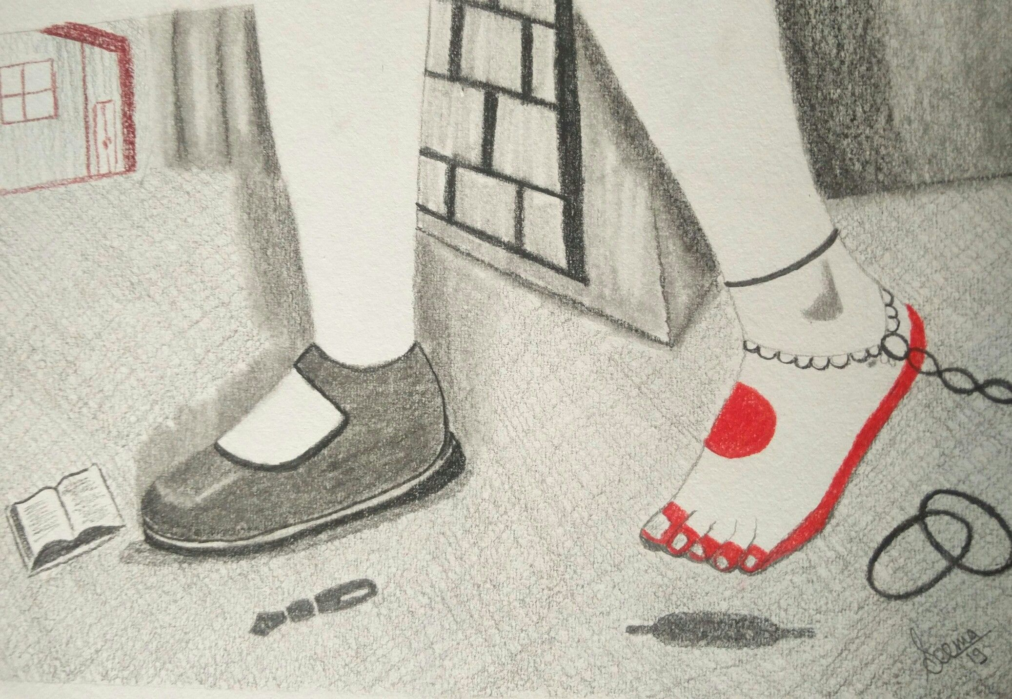 Girl child having school shoe in one foot while schakles in other.