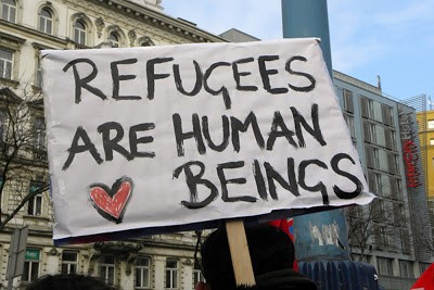 This image is from a peaceful protest for standing up with refugees and that refugees are human beings too!