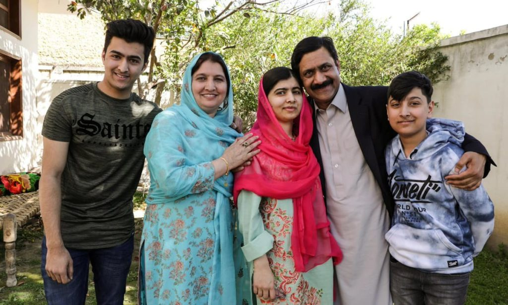 This image shows a picture of Malala Yousafzai's family with her parents and younger brothers.