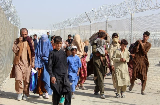 An image showing refugees going fleeing from the Taliban rule