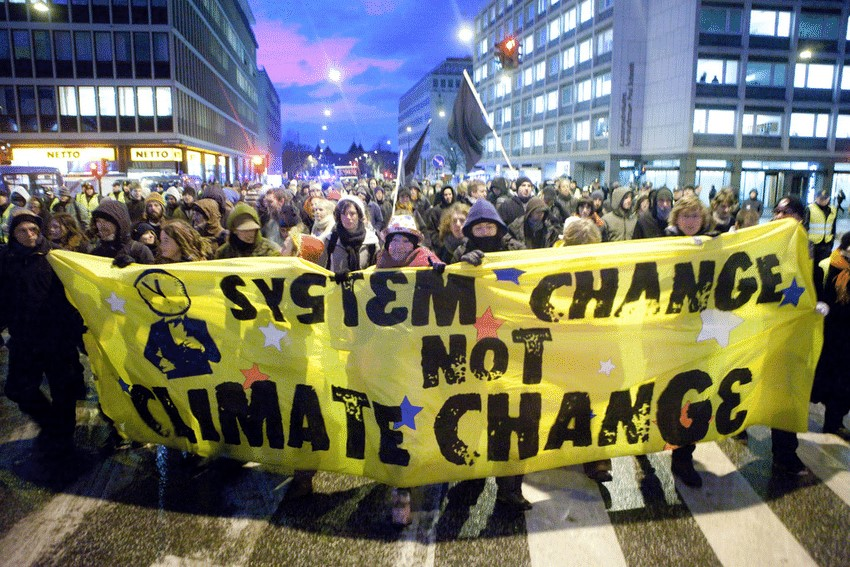 An image from a protest for System change and not Climate change