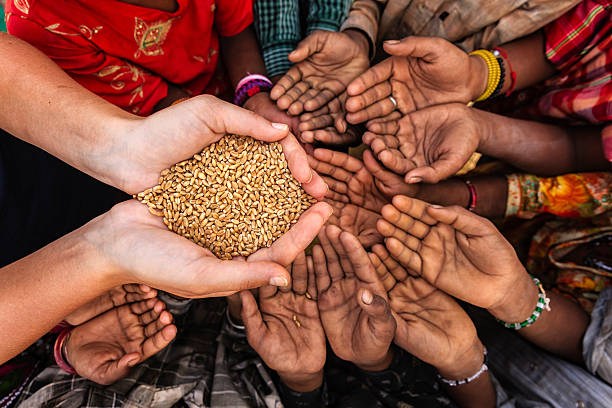 African children reaching out for food