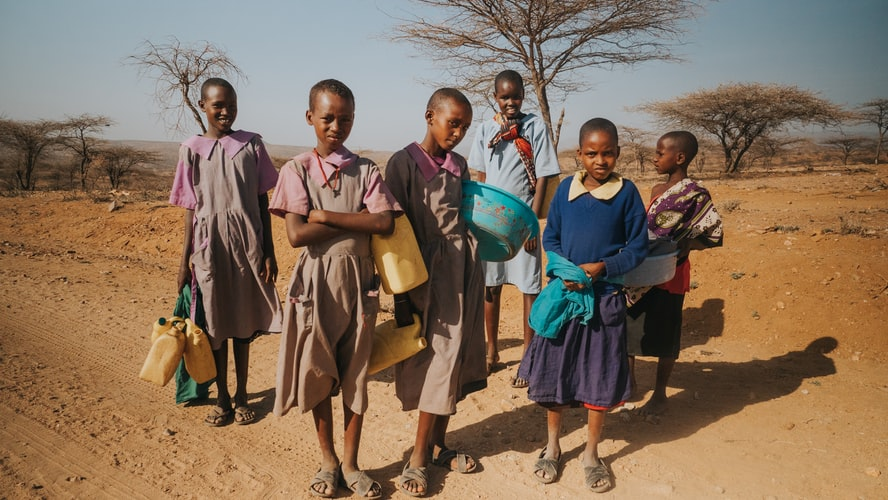 Local children fetching water and other supplies.